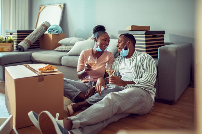 Young couple celebrating moving to their new home