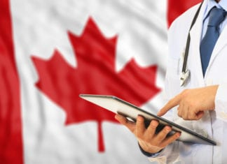 Doctor on Canada flag background - Canadian Healthcare