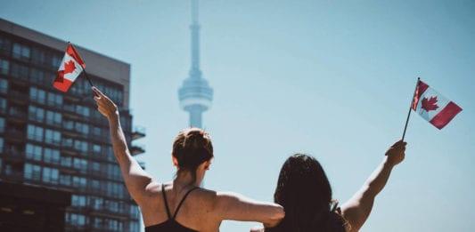 Girl wave Canadian Flag