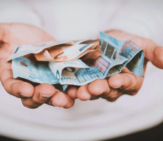 handing back Euros