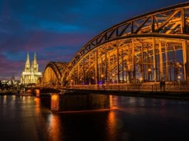 Hohenzollern Bridge with Cologne Cathedral in background.