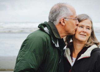 Retirement couple kissing