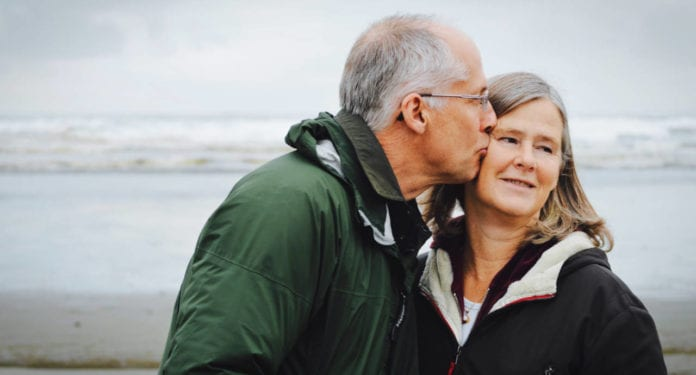 Retirement couple kissing