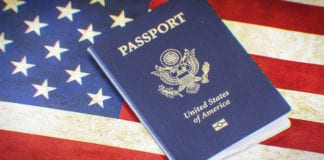 American passport on USA flag