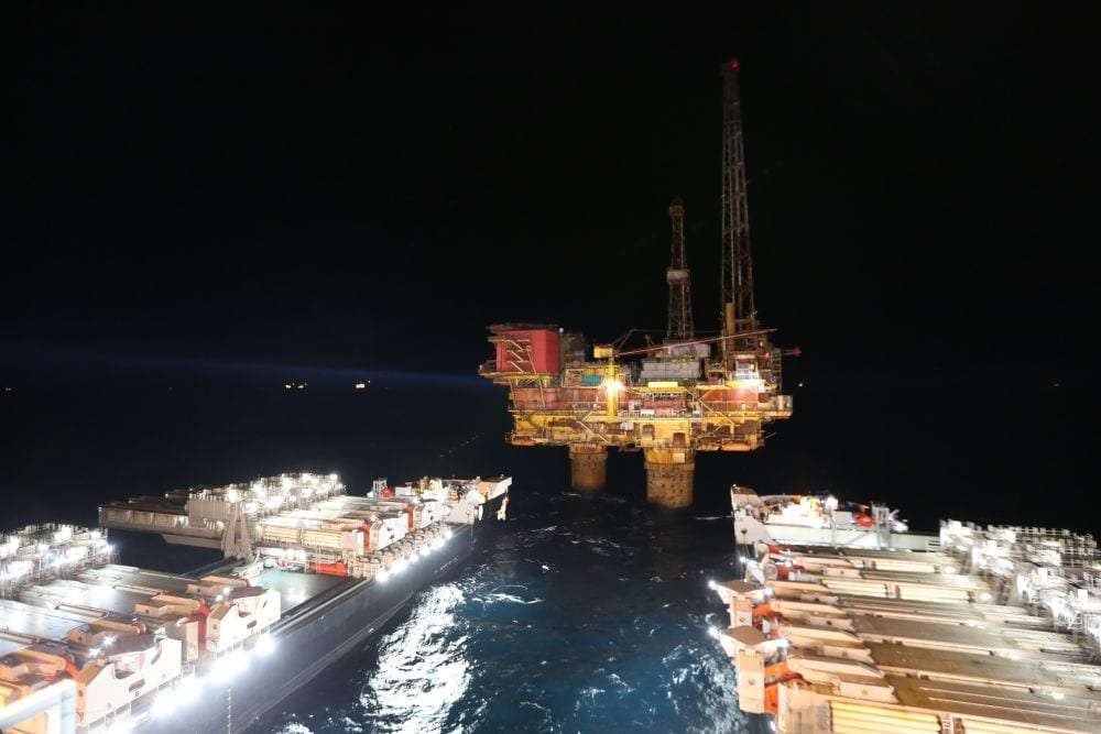 Pioneering Spirit approaches the rig.