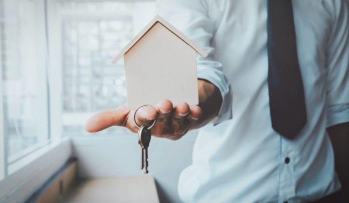 Agent handing rental keys over