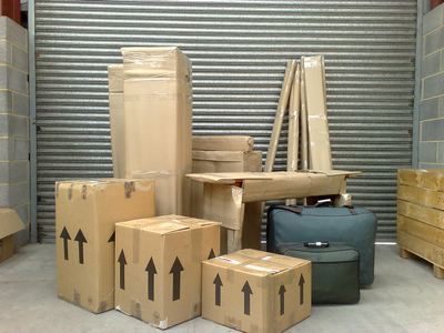 Goods and furniture securely packed in boxes and wrapped in cardboard.