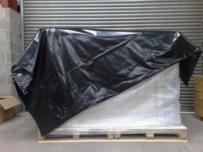 The pallet is then covered in our shrink-wrap film and heat treated for a tight fit.